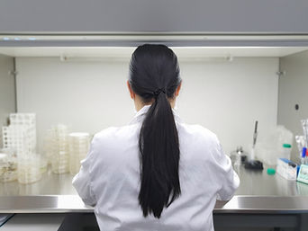 An Asian female scientist wearing an exp