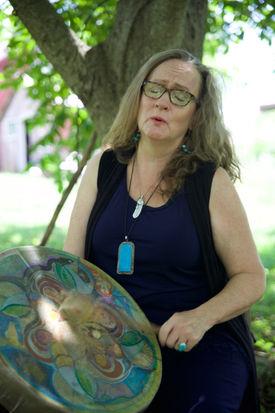 Rachel drumming under tree.jpg