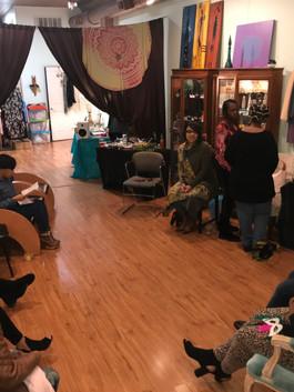 women sitting around in boutique storefront for women's workshop