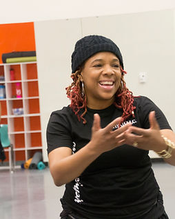 Mz.Flo the creator of FloFiyah smiling at dance students