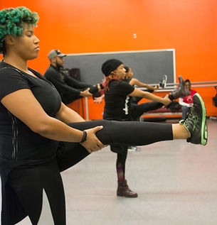 dance class in chicago ladies stretching legs