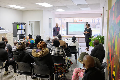 Two members of the Rafkiki team presenting to the community