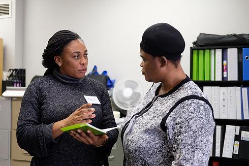 Woman speaking to interpreter