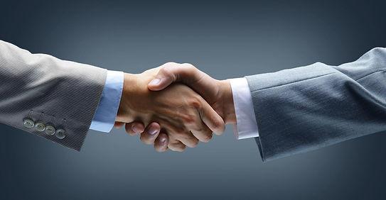 Handshake - Hand holding on black backgr