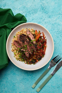 Beef with rich tomato sauce and Israeli couscous.jpg