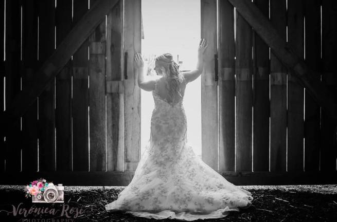 B&W Bride at doors of barn.jpg