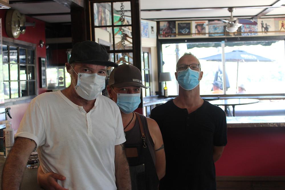 Jeff Hardill, Leigh Irvine, and 'sandwichist' Tom Werbo (right) have been hard at work keeping Kaffé 1870 running despite the pandemic. Stuart Benson photo
