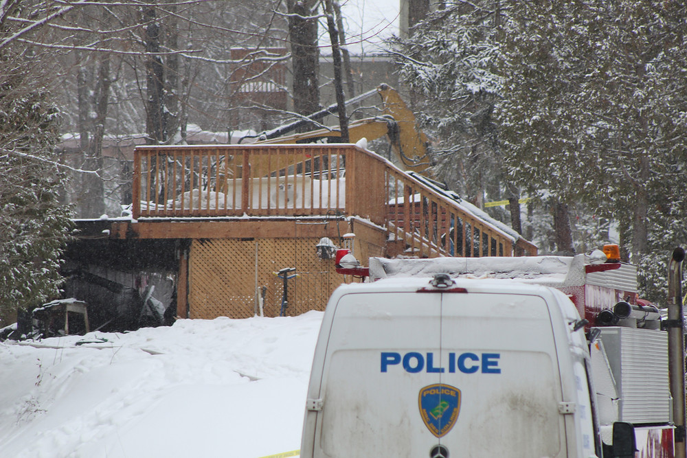 Investigations continued on Feb. 7, as fire crews and police investigators brought in an excavator to search for the bodies of two girls, who had gone missing after a fire destroyed a home on Chemin Murray in Sainte-Cécile-de-Masham just before 11 p.m. on Feb. 6. Stuart Benson photo
