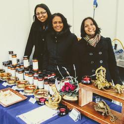 Three Swaadish sisters at a market