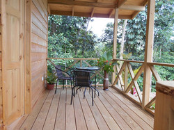 patio of wooden cabins forest lodge