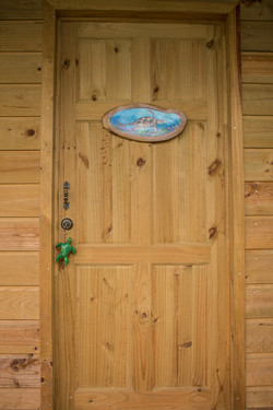 Puerta de entrada cabana tortuga