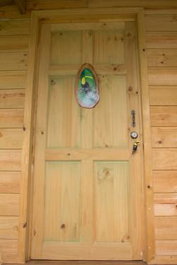 Puerta de entrada cabana tucan