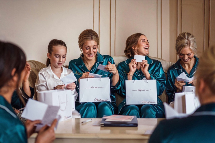 Bridal party opening gifts from Gosfield Hall Wedding