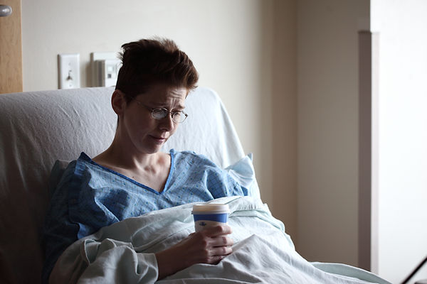 Woman in hospital bed.jpg