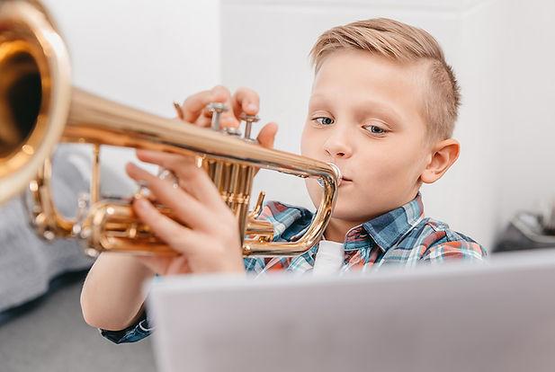 boy practicing trumpet.jpeg