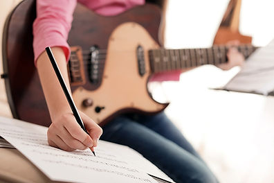 A girl composing music.jpg