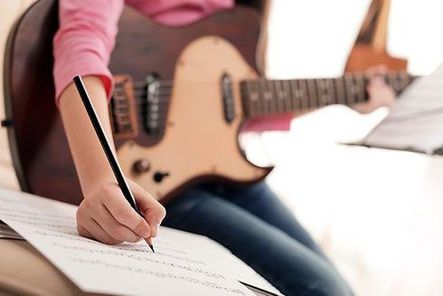 A girl composing music.jpg