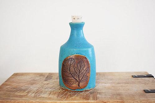 בקבוק לשמן זית עם עלה תאנה