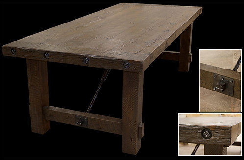 Rustic reclaimed dining table featuring wrought iron turnbuckle and bolt detailing and extra thick planks.
