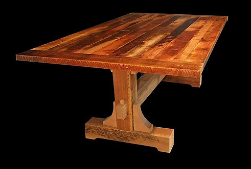Mill Boss reclaimed wood dining table with trestle base and corbel detail.