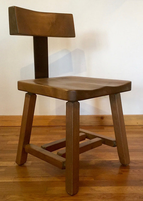 Modern rustic loft chair with flex metal back and stained alder wood.