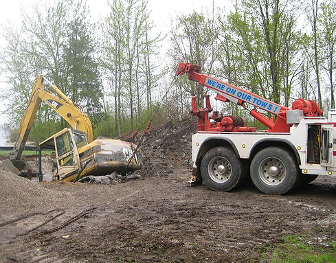 Quality Towing Services Truck Off-Road Recovery CAT Excavator