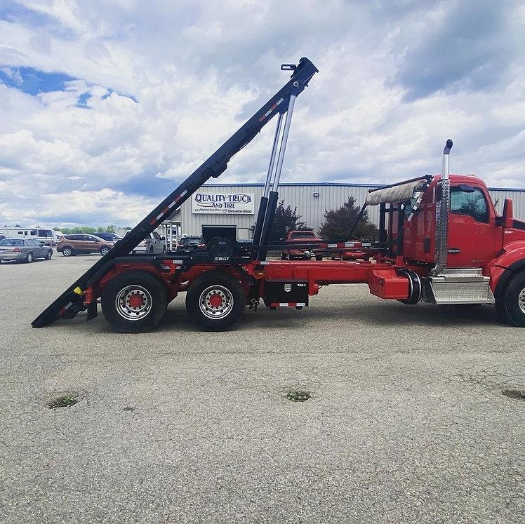 Red Custom Built Kenworth T-880 Roll Off Truck | Quality Truck Fab | Clare, MI 48617