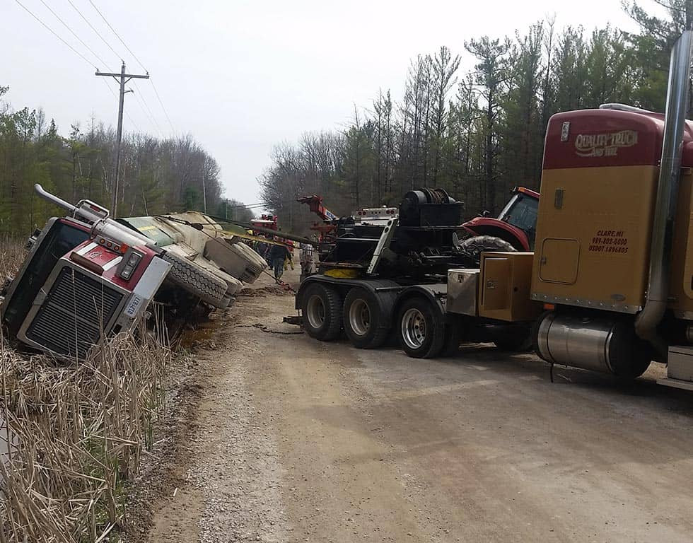Quality Towing Services heavy-duty semi pulling red semi | Quality Towing Services | Clare, MI 48617
