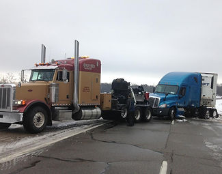 Quality Towing Services heavy-duty semi pulling blue semi | Quality Towing Services | Clare, MI 48617