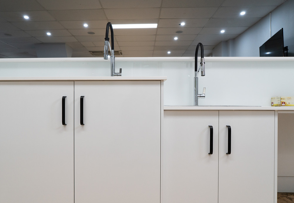 Two sinks, one at lower height and one higher.