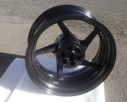 wide tire wheel in midnight black finish