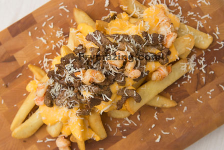 Super Fries: Angus beef and Tiger Prawns with cheese and cheese sauce over golden fries