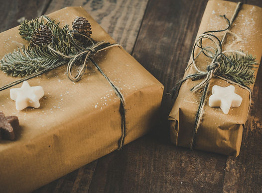 photo-of-two-brown-wrapped-gifts-on-wood