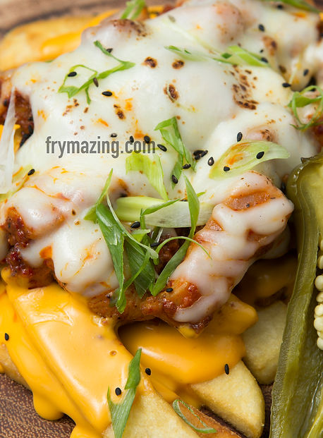 Radioactive Fries: Spicy Korean Chicken (Buldak) and melted mozzerella over fries