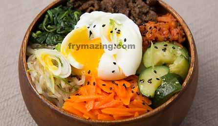 Bibimbob: A Classic Korean Dish.  Rice Bowl topped with Korean vegetables, Korean BBQ Beef (Bulgogi), and Kimchi.  Soft Boiled egg also available
