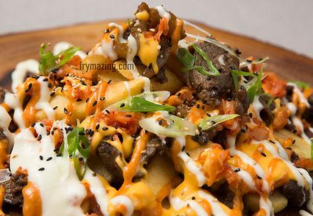Fire Fries: Korean BBQ Beef (Bulgogi), Kimchi, and Korean Chili Sauces on top of golden fries