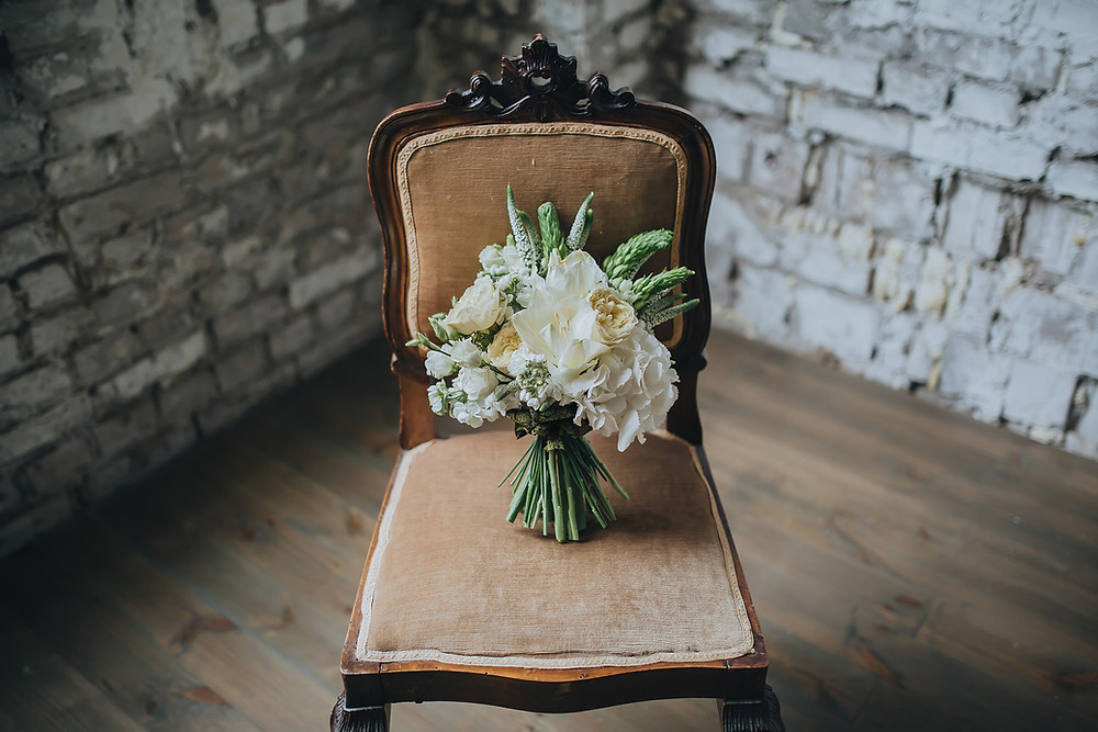 Nice wedding bouquet placed on the chair right before Danish wedding