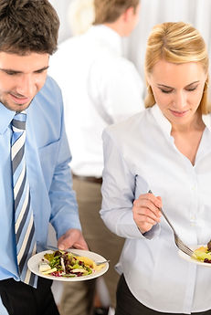 Business colleagues serve themselves at