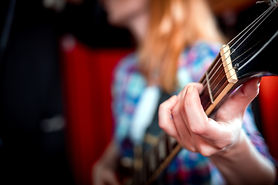 female-singer-with-electric-guitar-recor