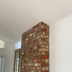 Where the reclaimed red bricks hit the Axon Ceiling