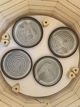 Cermaic circle plates with swirl design in the kiln