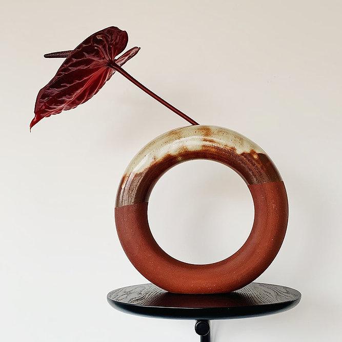 Circular ceramic vase with Anthurium stem