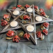 Pentagram rose tealight holder £25