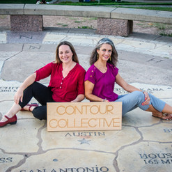 Two people sitting on Texas map in front of Austin, with a Contour Collective wooden sign