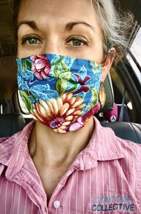 Elaine in a car with fabric face mask on