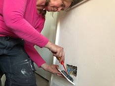 Rachel from She Sparks fitting a wall socket.