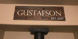 wooden sign with last name