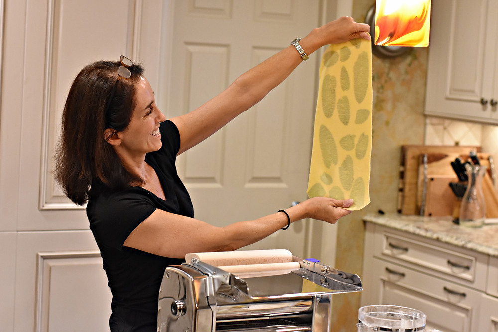 Laurie Boucher holding up laminated pasta
