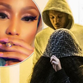 Nicki Minaj hides her face after furious crowd chants 'Cardi B' following ANOTHER cancelled show