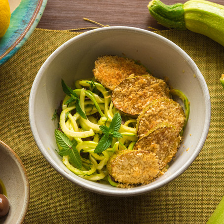 Zucchini and Parmesan Fritters on a Shaved Zucchini Salad with a Lemon and Mint Vinaigrette